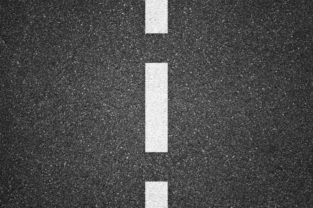 Asphalt texture background with white lines Imagens