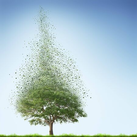 disintegrate: Tree with green grass over blue sky background