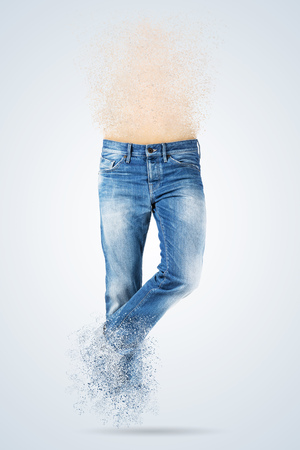 disintegrate: Blue jeans trouser over blue background