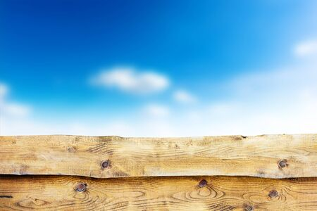 Wooden fence against blue sky background