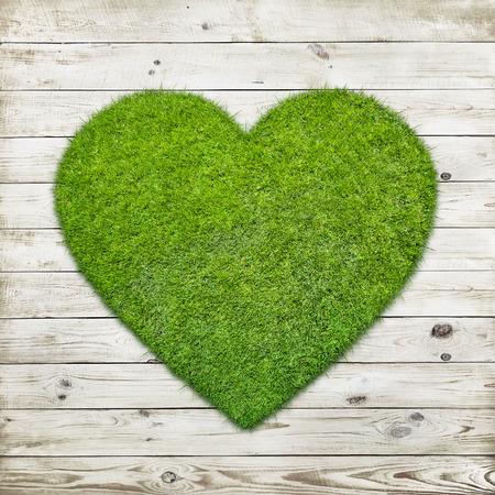green grass: Heart shape of green grass over wood background