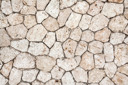 housebreaking: old cracked stones wall background