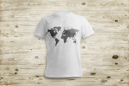 over white: White shirt with map shape over wood background