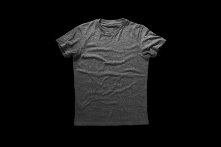 Grey shirt over black background Imagens