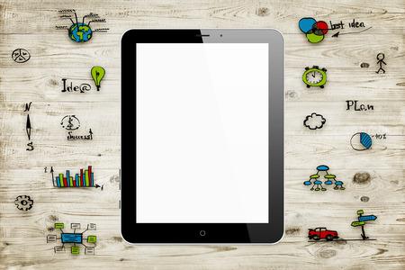 ordinateur tablette sur des planches de bois avec des croquis d'affaires. fond concept d'affaires Banque d'images