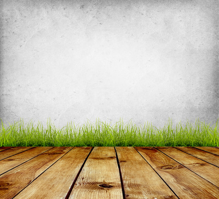wood grass: Old wall and green grass on wood floor background Stock Photo