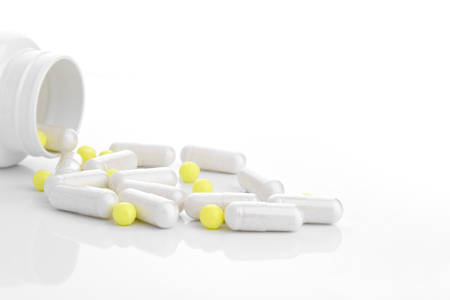 lecithin: medicine capsules scattered on a white background with room for text