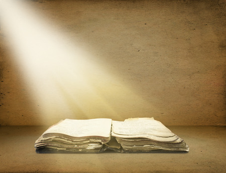 sayings: Old book with Ray of light