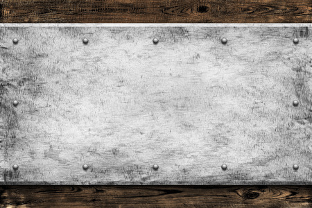 rusty nail: Wood with metal texture background