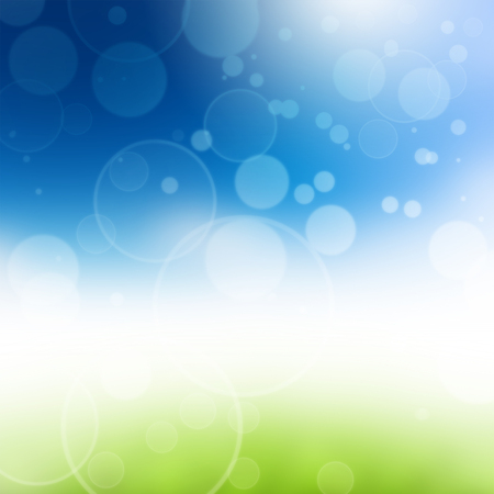 Green grass over a blue sky. Beauty natural background Stock Photo