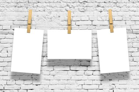 old wallpaper: Photo frames with pins on rope over old aged brick wall background Stock Photo