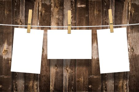 aged wood: Photo frames with pins on rope over old aged wood wall background Stock Photo
