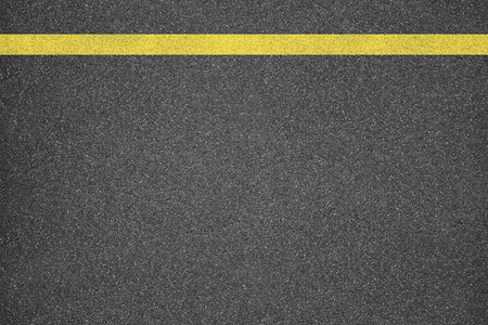 yellow line: Asphalt texture background with yellow line