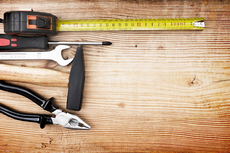 wooden floors: Close up tools on a wooden background