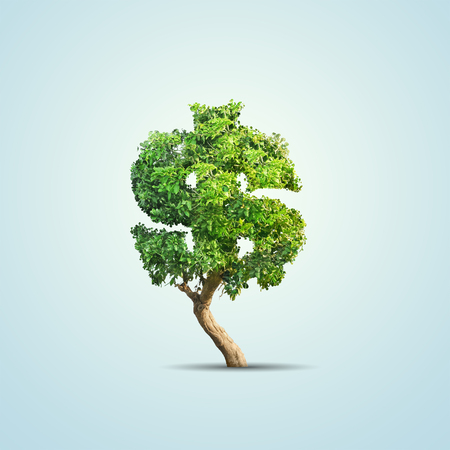 Green tree shaped in dollar sign isolated on blue background Standard-Bild