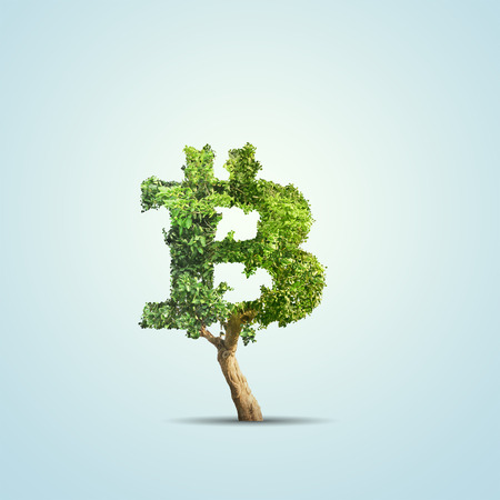 Green tree shaped in bitcoin sign isolated on blue background