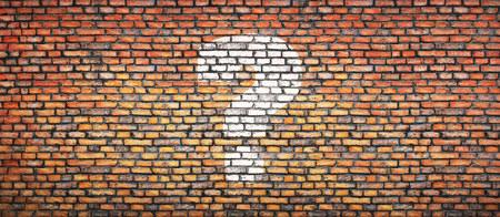 Brick wall with question sign. Concept background