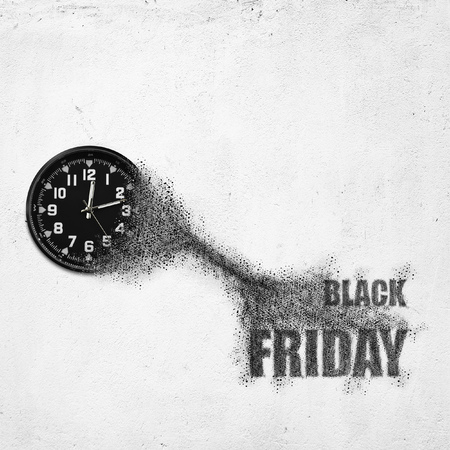 Classic clock on white concrete background disintegrate in a small parts and flying into words BLACK FRIDAY. Time flying concept Stock Photo