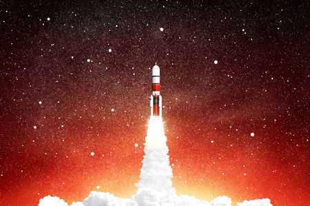 Rocket launching in space sky with stars. Imagens