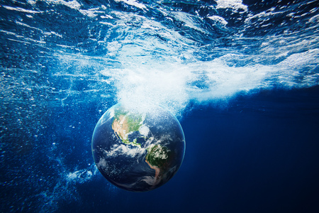 Planet Earth underwater. Conceptual nature background. Stock Photo