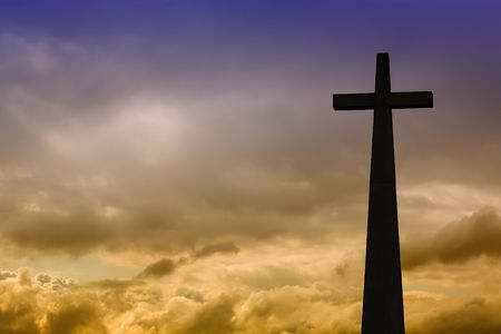 cross detail in silhouette and the clouds in the sky Stock Photo