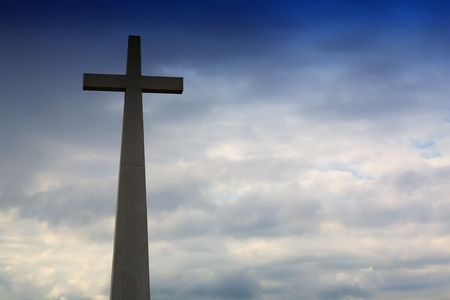 cross in silhouette and the clouds in the sky Stock Photo