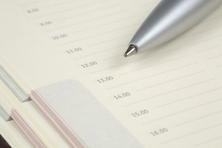 Checklist in an agenda with a silver ballpen