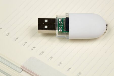 White pendrive and deily schedule