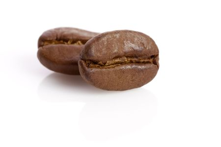tokens: Macro of two coffee beans Isolated image