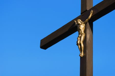 Detail cross with a blue sky background