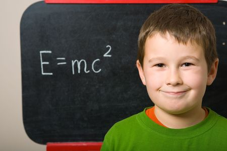 Schoolboy at the chalkboard Stock Photo - 3785551