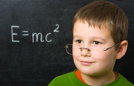 Portrait of happy boy before blackboard Stock Photo