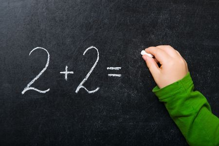 Simple math formula written on chalkboard Stock Photo