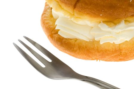 sweetness: Puff cake with cream over white background Stock Photo