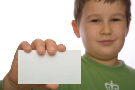 A boy holding a card ready for your text Stock Photo