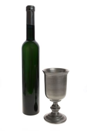 Silver wine goblet and bottle isolated on white background.