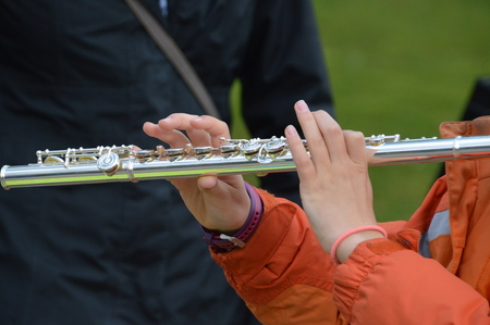 the transverse: Girl Playing On A Transverse Flute Stock Photo