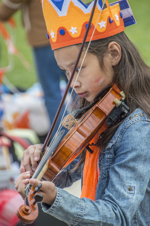 Girl Playing The Violin In The Vondelpark On Kingsday At Amsterdam The Netherlands 2018 Editoriali