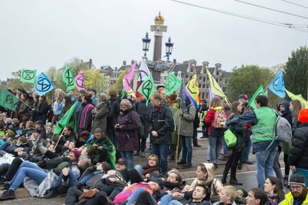Group Protesters At The Climate Demonstration From The Extinction Rebellion Group At Amsterdam The Netherlands 2019
