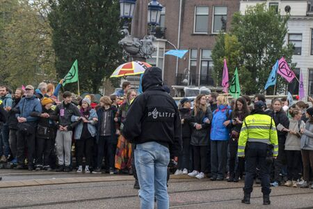 Police At Work At The Blauwebrug At The Climate Demonstration From The Extinction Rebellion Group At Amsterdam The Netherlands 2019