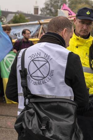 Police Liaison At Work At The Blauwebrug At The Climate Demonstration From The Extinction Rebellion Group At Amsterdam The Netherlands 2019