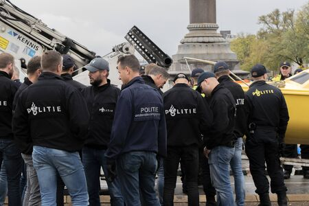 Police Regrouping At The Blauwebrug At The Climate Demonstration From The Extinction Rebellion Group At Amsterdam The Netherlands 2019