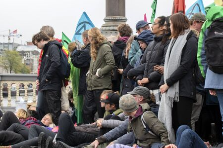 Protesters Holding Together At The Blauwebrug At The Climate Demonstration From The Extinction Rebellion Group At Amsterdam The Netherlands 2019