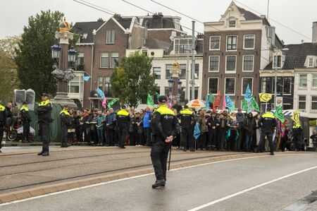Police Surrounding Protesters At The Climate Demonstration From The Extinction Rebellion Group At Amsterdam The Netherlands 2019 報道画像