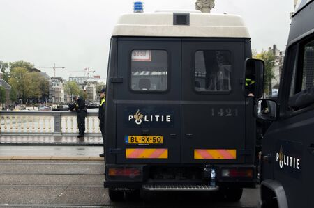 Police Watching The Demonstration At The Blauwebrug At The Climate Demonstration From The Extinction Rebellion Group At Amsterdam The Netherlands 2019