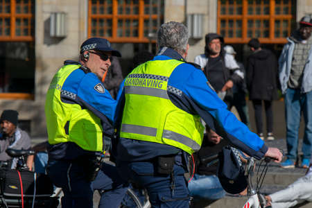 Handhaving Patrolling On The Dam Square During The Corona Virus Outbreak At Amsterdam The Netherlands 2020 Editorial