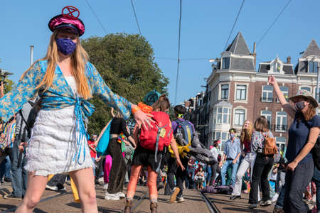 Rebellion Extinction Demonstrators Dancing At The Blauwbrug Bridge At Amsterdam The Netherlands 19-9-2020 Editorial