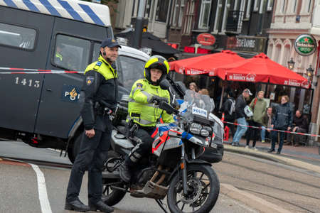 Police Motor With Two Police Men At Amsterdam The Netherlands 12-10-2019