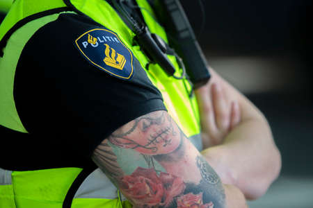Female Police Woman With Tattoos At Amsterdam The Netherlands 25-9-2020
