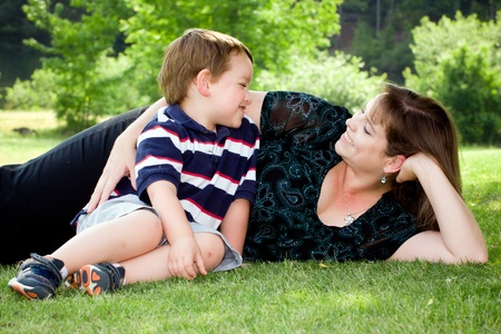 Mother and son play outside on field on Mother's Day. Stock Photo - 9673205